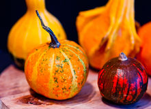 Pumpkins for Halloween with funny friends who play with ghosts - royalty free illustration