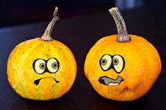 Pumpkins for Halloween with funny friends who play with ghosts -. The famous halloween pumpkins get some nice friends who accompany you to make jokes and ask for Royalty Free Stock Images