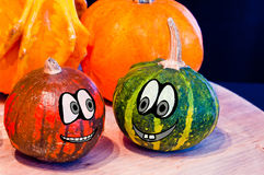 Pumpkins for Halloween with funny friends who play with ghosts -. The famous halloween pumpkins get some nice friends who accompany you to make jokes and ask for Stock Photography