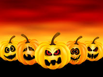 Pumpkins for Halloween. Vector illustration for Halloween with funny pumpkins at sunset Royalty Free Stock Images