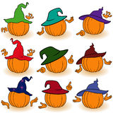 Pumpkins in hats view from the back Royalty Free Stock Image
