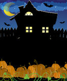 Pumpkins and haunted house Royalty Free Stock Image