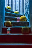 Pumpkins and lanterns on the steps in the house Royalty Free Stock Photo