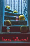 Pumpkins and lanterns on the steps in the house Stock Photography