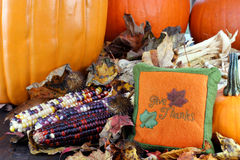 Pumpkins, leaves and Indian corn Royalty Free Stock Photo