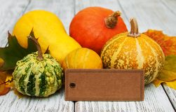 Pumpkins and leaves. Pumpkins and autumn  leaves on a old wooden table Stock Photo