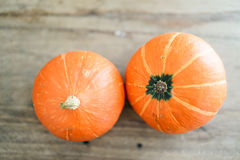 Pumpkins on the light wood Royalty Free Stock Photography