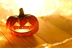 Pumpkins and lights decorate the halloween day. On the wooden floor Royalty Free Stock Photos