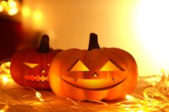Pumpkins and lights decorate the halloween day. On the wooden floor Stock Images