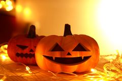 Pumpkins and lights decorate the halloween day. On the wooden floor Stock Image