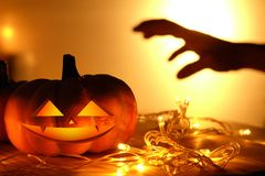 Pumpkins and lights decorate the halloween day. On the wooden floor Royalty Free Stock Photo