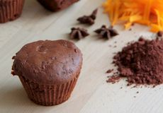 Pumpkins muffin with dark cocoa, gingerbread spices and plum butter. Stock Photo