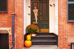 Pumpkins near the door for Halloween Stock Image