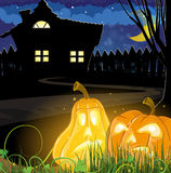 Pumpkins near a haunted  house Royalty Free Stock Photography