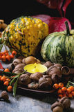 Pumpkins, nuts and candle Royalty Free Stock Photography