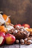 Pumpkins, nuts, indian corn and apples Stock Photos