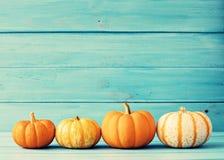 Pumpkins Over Wood Stock Image