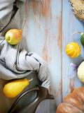 Pumpkins, pears, apples, gray fabric on a light wooden table, concept of cooking for a seasonal home holiday. Harvest, autumn, top view stock photography