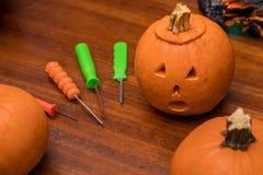 Pumpkin carving. Pumpkins with a pumpkin carving kit stock photos