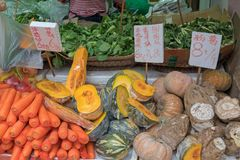 Pumpkins. And Carrots at Farmers Market royalty free stock photos