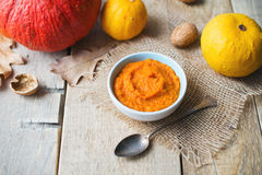 Pumpkins puree with over tableware and vegetable. Royalty Free Stock Photo