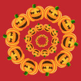 Pumpkins in round on red Royalty Free Stock Photos