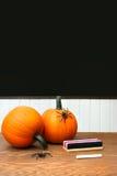 Pumpkins on school desk  in classroom Stock Photos
