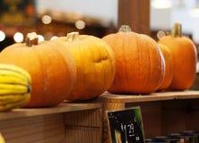 Pumpkins on shelf Stock Photo