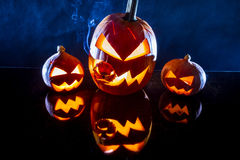 Pumpkins, smoke and black background Stock Photos