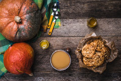 Pumpkins, soup, honey and cookies with nuts on wood Stock Photos