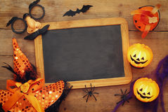 Pumpkins, spiders, bats and blackboard on wooden old table Stock Photo