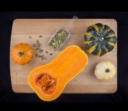 Pumpkins, squash and seeds Stock Photos
