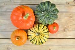 Pumpkins on wooden background Stock Photos
