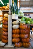 Pumpkins stacked up at a market royalty free stock photography