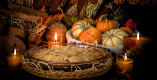 Pumpkins still life. Pumpkins and cake on candle light still life Stock Photo