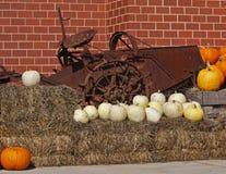 Pumpkins straw antique farm machine Royalty Free Stock Images