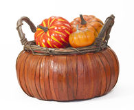 Pumpkins in Straw Basket Royalty Free Stock Photo