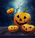 Pumpkins on table with Halloween background Royalty Free Stock Photos