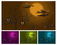 Pumpkins on trees Royalty Free Stock Image