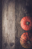 Pumpkins and turnip on the wooden table vertical Royalty Free Stock Photography