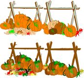 Pumpkins under a fence Stock Image