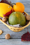 Pumpkins in a wicker basket Stock Images