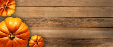 The pumpkins on the wood board royalty free stock image