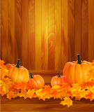 Pumpkins on wooden background with leaves. Stock Photography