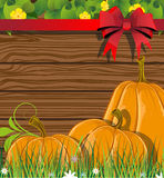 Pumpkins on the wooden background Royalty Free Stock Image