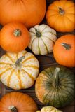 Pumpkins on wooden background Royalty Free Stock Photography