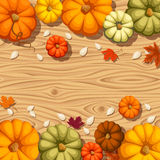 Pumpkins on a wooden background. Vector seamless background. Royalty Free Stock Photo
