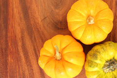 Pumpkins on wooden board Royalty Free Stock Photos