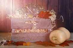 Pumpkins in wooden crate Stock Photography