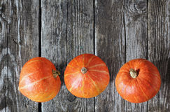 Pumpkins on Wooden Planks Stock Photo